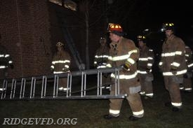 Lt. Jordan Andrews prepares to properly place a ladder for ventilation.