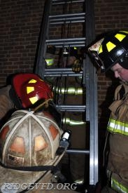 Chief 4A and crew preparing to review the ladder flip technique to make a quick horizontal  ladder move.