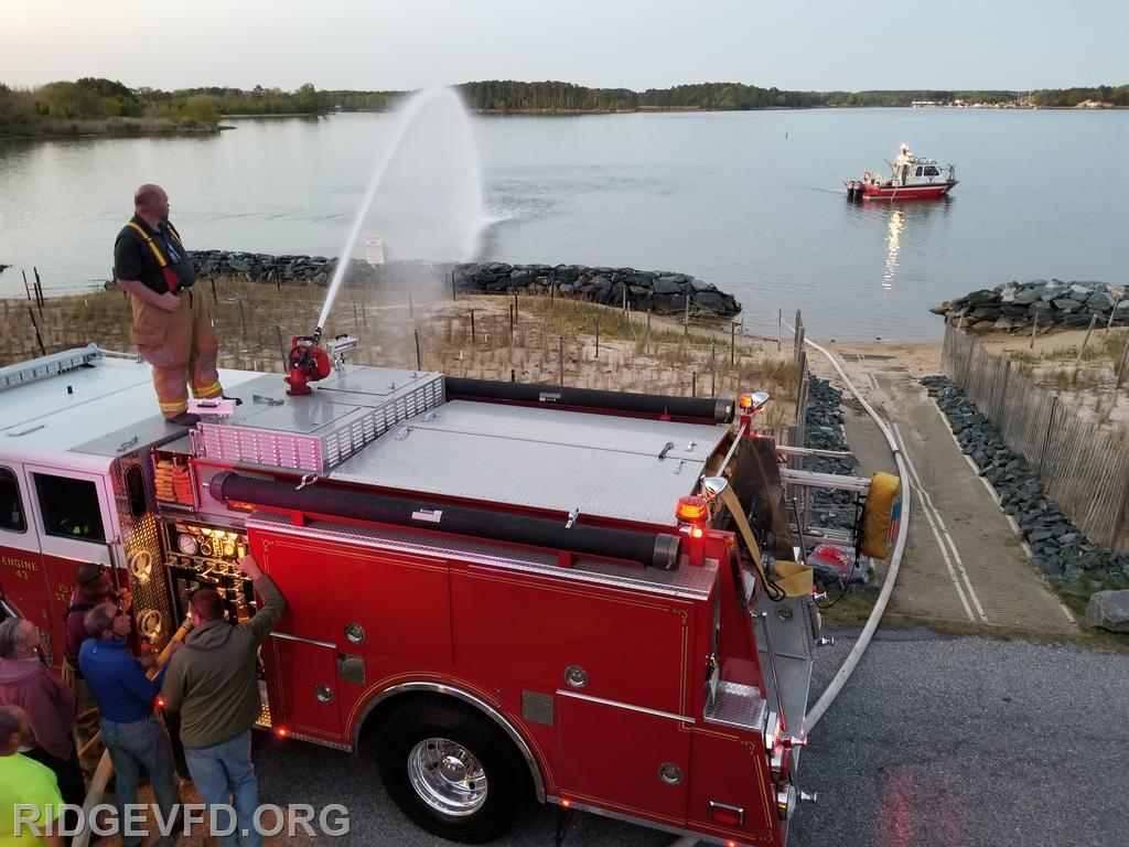 Engine 43 flows supplied water through deck gun